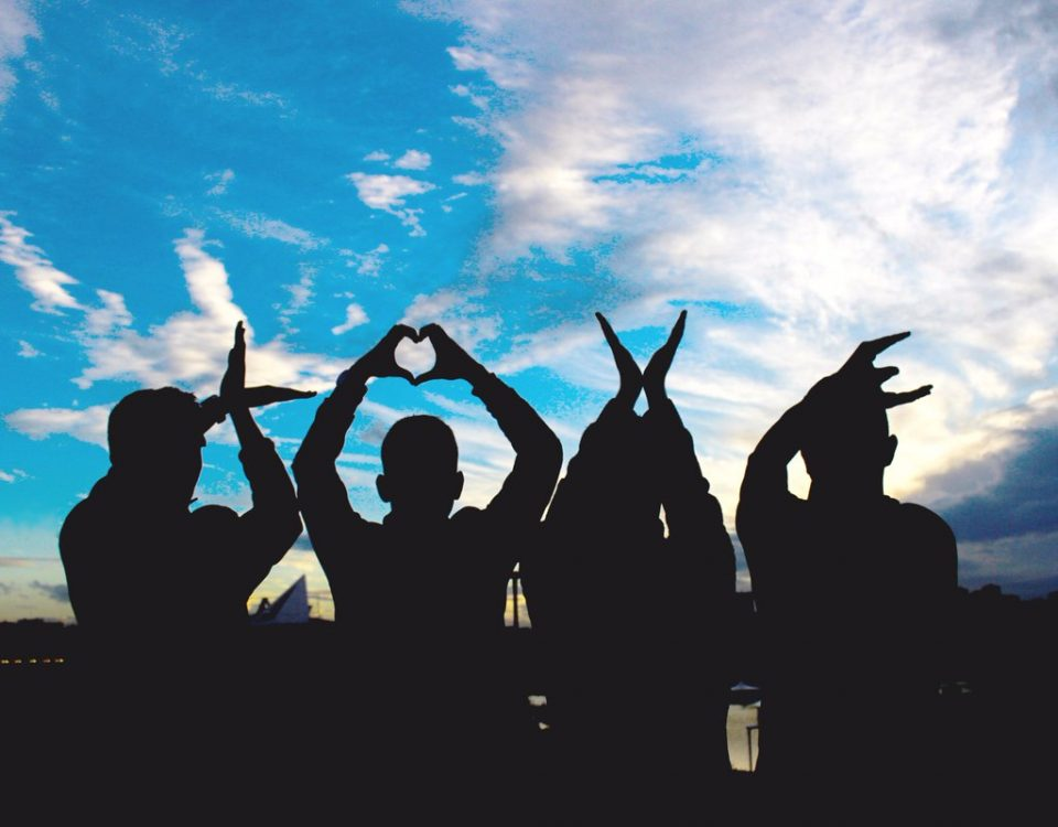 a group of people with hands illustrating LOVE