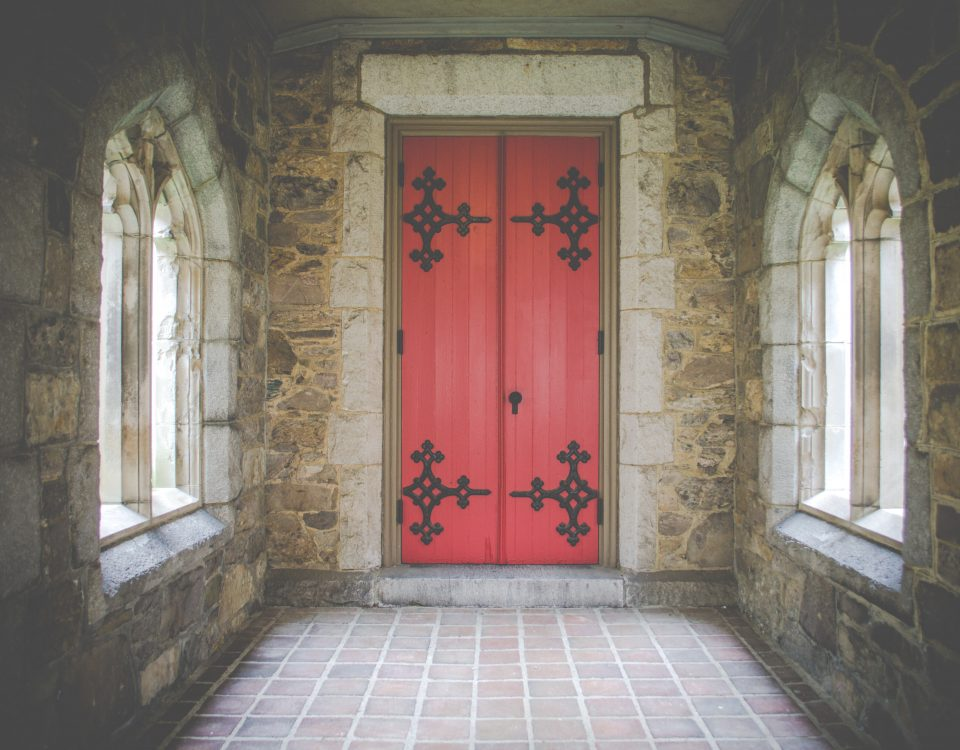 the power of doors, red door in cathedral with windows